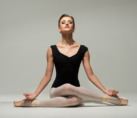 Beautiful young ballerina dancer meditating  photo