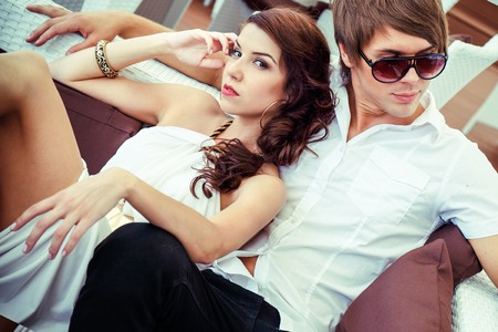 Young sexy couple relaxing on summer cafe terrace  photo