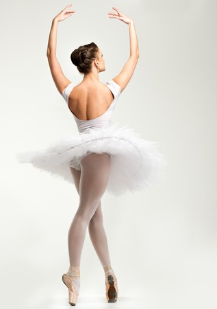 Young ballerina dancer in tutu showing her techniques  photo