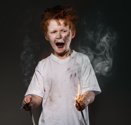 Little redhead bad boy with sparkling wires photo