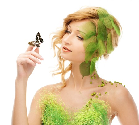 butterfly and women: Dreaming young woman in conceptual spring costume with butterfly Stock Photo