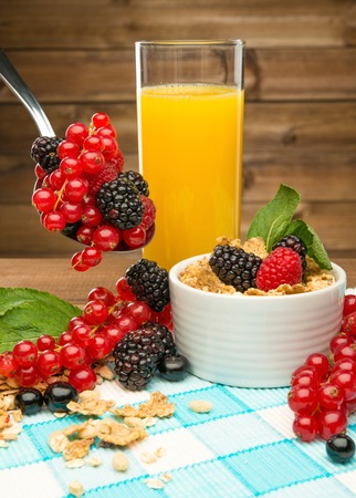Healthy breakfast with fresh orange juice on tablecloth in wooden rural interior  photo