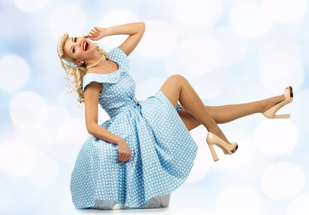 coquete: Sexy coquette blond pin up style young woman in blue dress