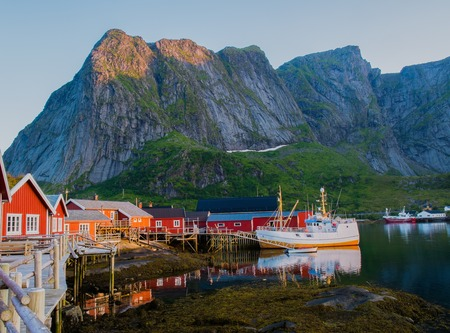 Traditional fishing boat in Reine village, Norway photo