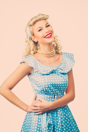 Sexy blond pin up style young woman in blue dress photo