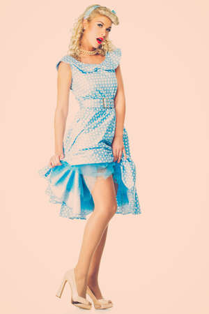 Sexy coquette blond pin up style young woman in blue dress Stock Photo - 26871140