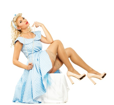 coquete: Sexy coquette loira pin up estilo jovem mulher no vestido azul Banco de Imagens
