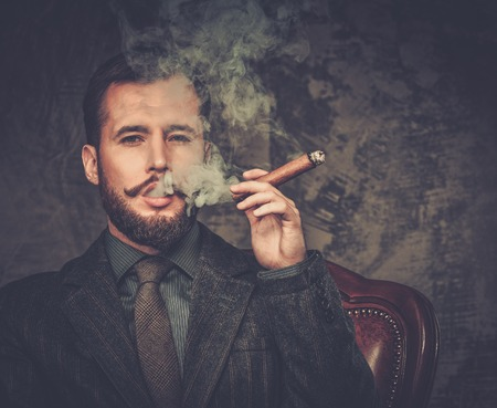 cigars: Handsome well-dressed with glass of beverage and cigar Stock Photo