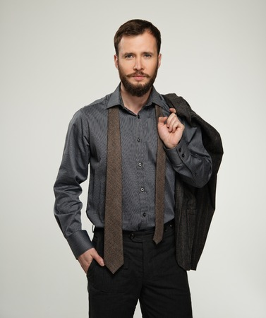 Handsome man with jacket over his shoulder photo
