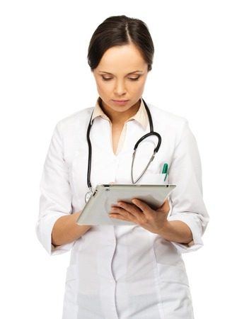 taking notes: Young brunette doctor woman taking notes on tablet pc