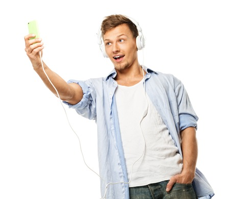 Stylish happy man in headphones taking selfie isolated on white  photo