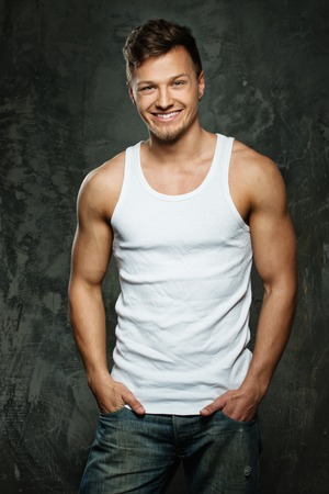 men body: Stylish cheerful man in tank top shirt