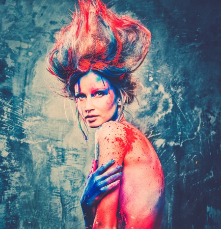 Young woman muse with creative body art and hairdo  photo