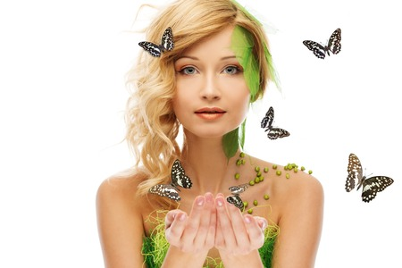 Beautiful young woman in conceptual spring costume with butterflies around her photo