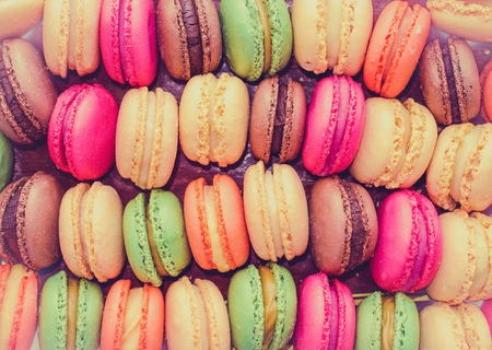 Colourful tasty macaroons in a row photo