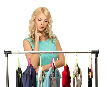 woman closet: Blond woman choosing clothes on a rack  Stock Photo