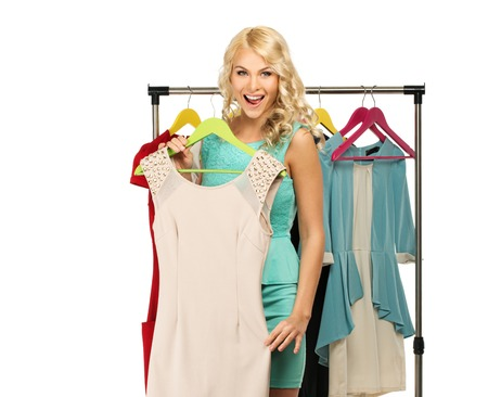 clothes rack: Smiling blond woman choosing clothes on a rack