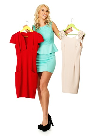choosing clothes: Smiling blond woman choosing clothes  Stock Photo