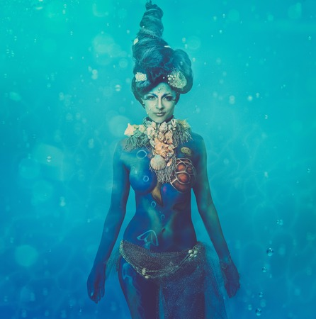 Fantasy underwater woman creature with body art  photo