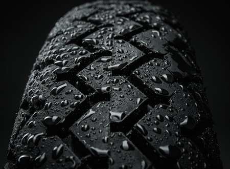 Close-up shot of classical motorcycle tire tread in wet weather condition  photo