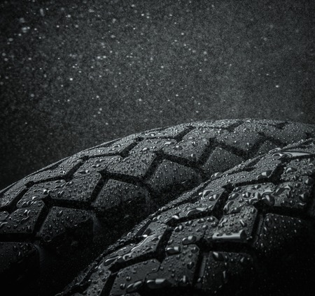 Close-up shots of classical motorcycle tires tread in wet weather condition  photo