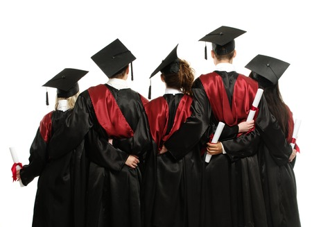 mantles: Group of graduated young students in black mantles  Stock Photo