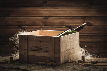 fine wood: Bottle of wine in box in wooden interior