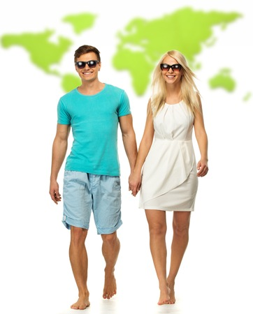 Beautiful smiling young couple against world map photo