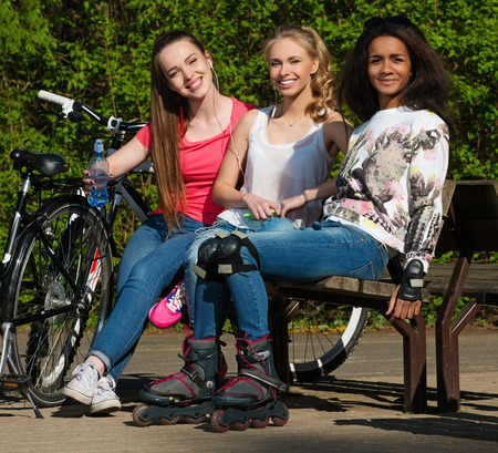 Multi ethnic group of sporty teenage girls in a park photo