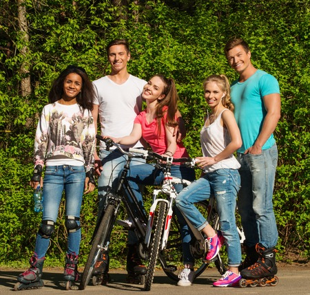 multi ethnic: Multi ethnic group of sporty teenage friends in a park  Stock Photo