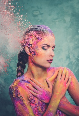 frailty: Beautiful young woman with conceptual colourful body art  Stock Photo