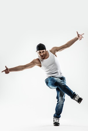 Man dancer showing break-dancing moves isolated on white