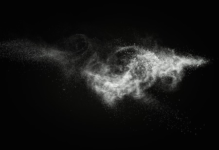 particles: White powder exploding isolated on black