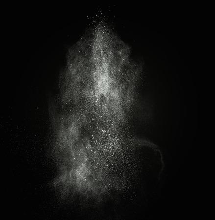 ashes: White powder exploding isolated on black