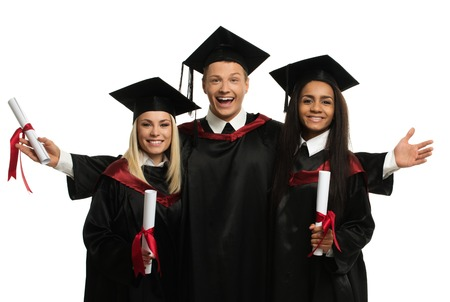 college graduation: Multi ethnic group of graduated young students isolated on white