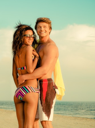 Multi ethnic young couple on a beach  photo
