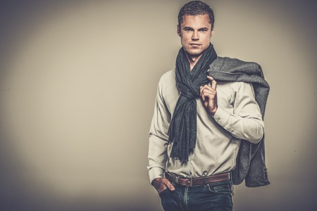 good looks: Handsome young man in casual jacket and neck scarf Stock Photo