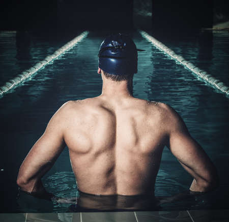 human back: Muscular swimmer in a swimming pool