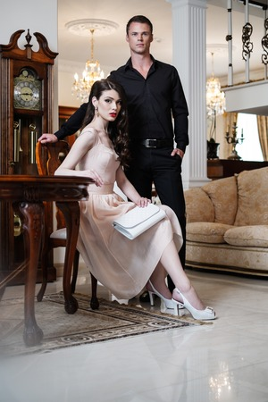 elegant couple: Young couple in luxury home interior