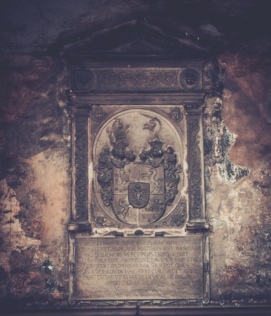 memorable: Coat of arms and old text on memorable wall Stock Photo
