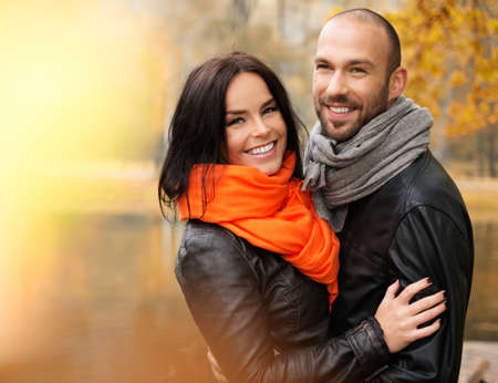 mid thirties: Happy middle-aged couple outdoors on beautiful autumn day Stock Photo
