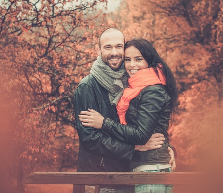 mid age: Happy middle-aged couple outdoors on beautiful autumn day Stock Photo