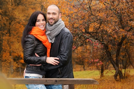 male age 40's: Happy middle-aged couple outdoors on beautiful autumn day Stock Photo