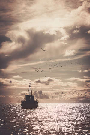 Fishermans boat in a sea Stock Photo