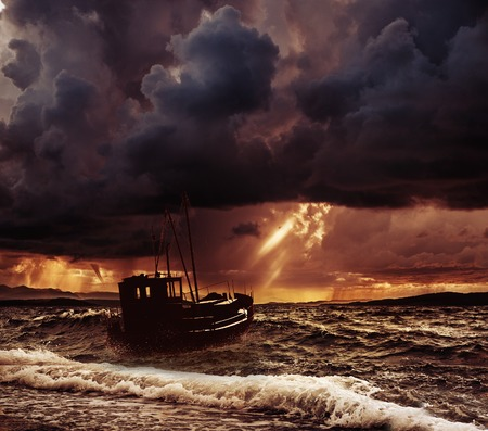 Fishing boat in a stormy sea  photo