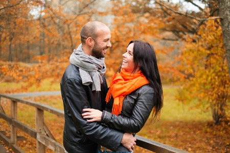 mid adult men: Happy middle-aged couple outdoors on beautiful autumn day Stock Photo