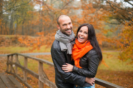 mid adult couple: Happy middle-aged couple outdoors on beautiful autumn day Stock Photo
