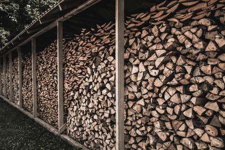 sawed: Stockpile of sawed logs under shed