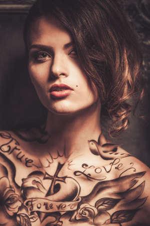 tattooed: Beautiful woman with tattoos  Stock Photo