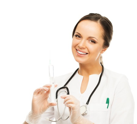 nurse injection: Young positive brunette doctor woman with syringe isolated on white  Stock Photo